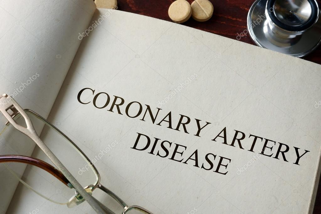 Book with diagnosis coronary artery disease and pills.