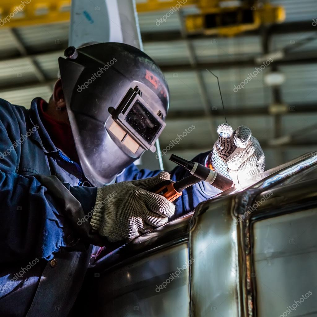 Man Welding With Reflection Of Sparks On Visor Hard Job Stock Photo C Sarymsakov 63421463