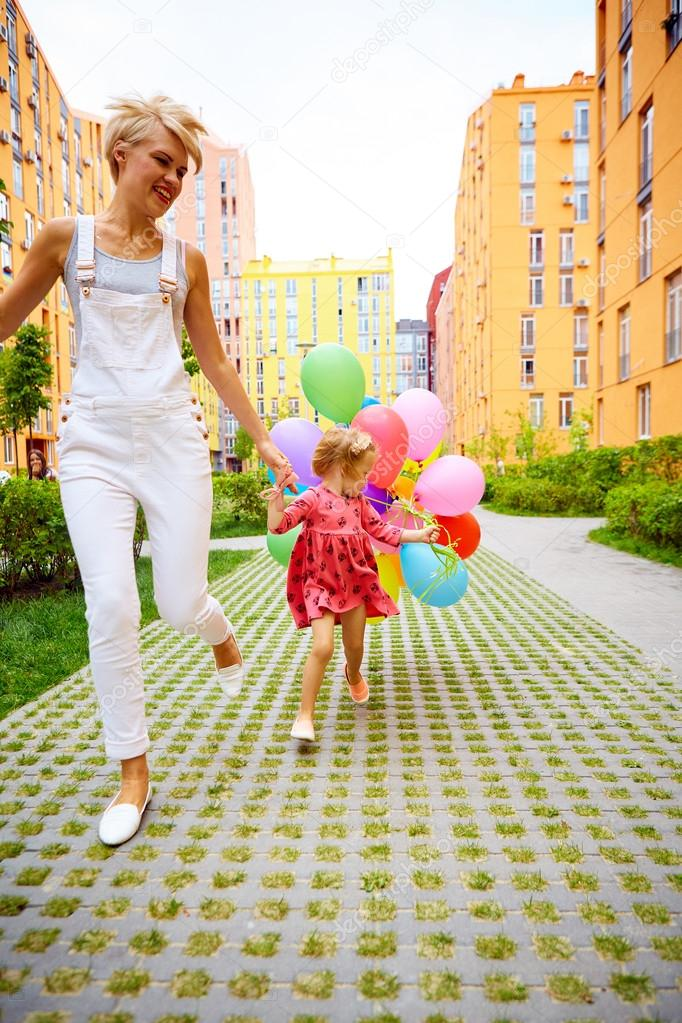 mother and child with colorful balloons
