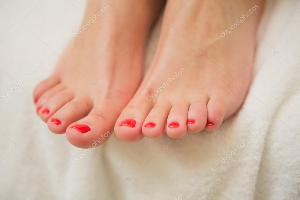 pretty toes with red nail polish stock photo sarymsakov 99887382