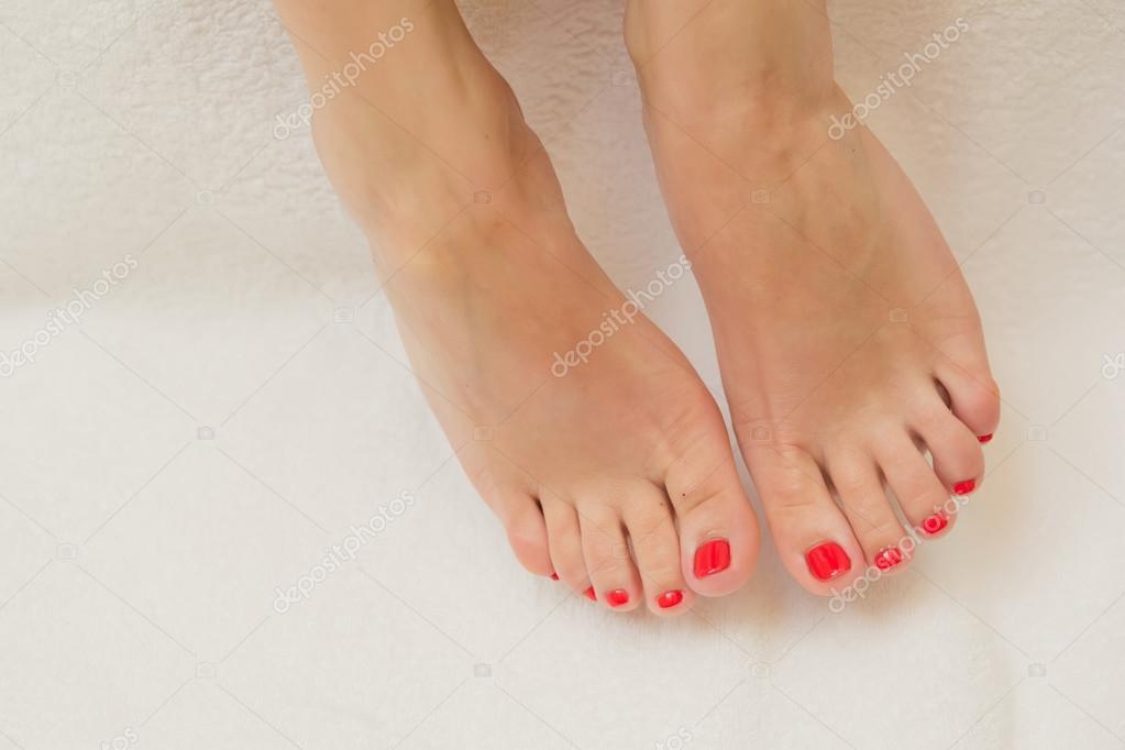 pretty toes with red nail polish stock photo sarymsakov 99887614