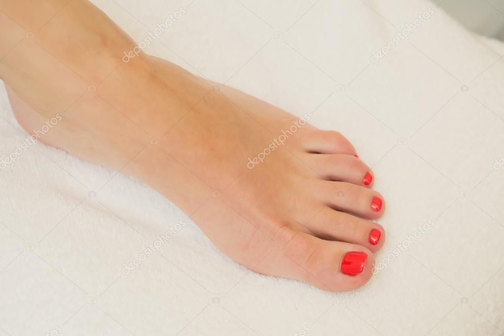 pretty toes with red nail polish stock photo sarymsakov 99887660
