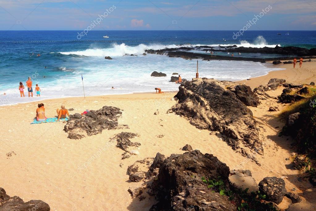 On beach Boucan Canot Beach, Reunion