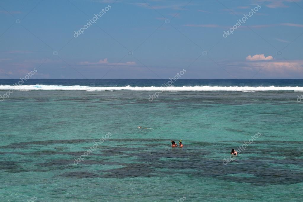 Bathing in lagoon Hermitage, Reunion