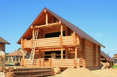 Wooden housing construction. New wooden house