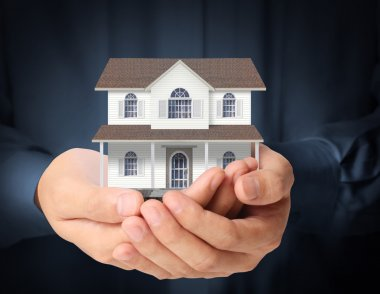 holding house representing home ownership
