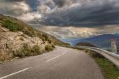 Mountain road and moody skies in Corsica