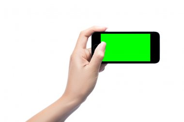 Woman hand holding mobile smart phone with green screen isolated