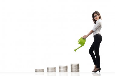 Image of business woman watering money,Currency concept