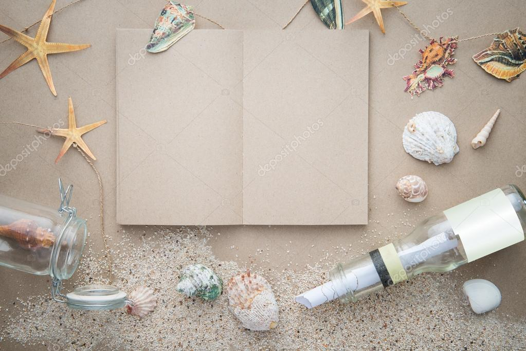 Blank book with sands and letter message in bottle