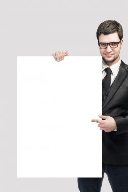 business man and blank board on white background