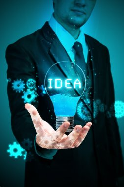 businessman holding idea light bulb