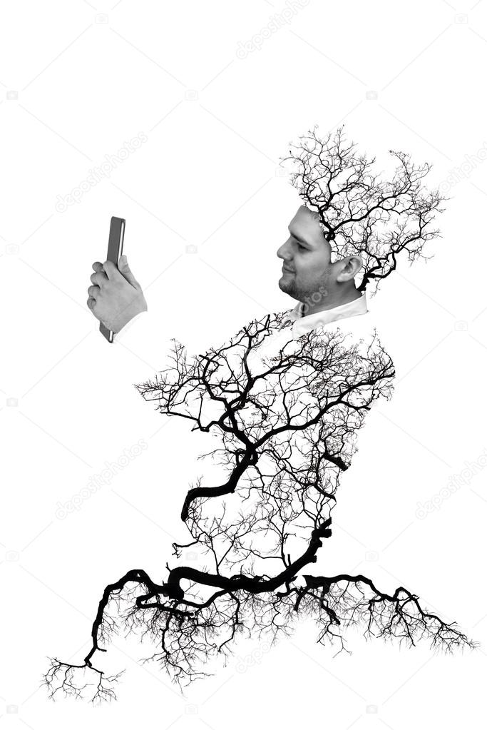 Double exposure portrait of Business man using digital tablet with tree and branch isolated on white