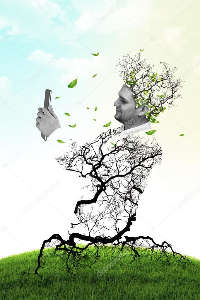 Double exposure portrait of Business man using digital tablet with trees and branch on sky clouds background