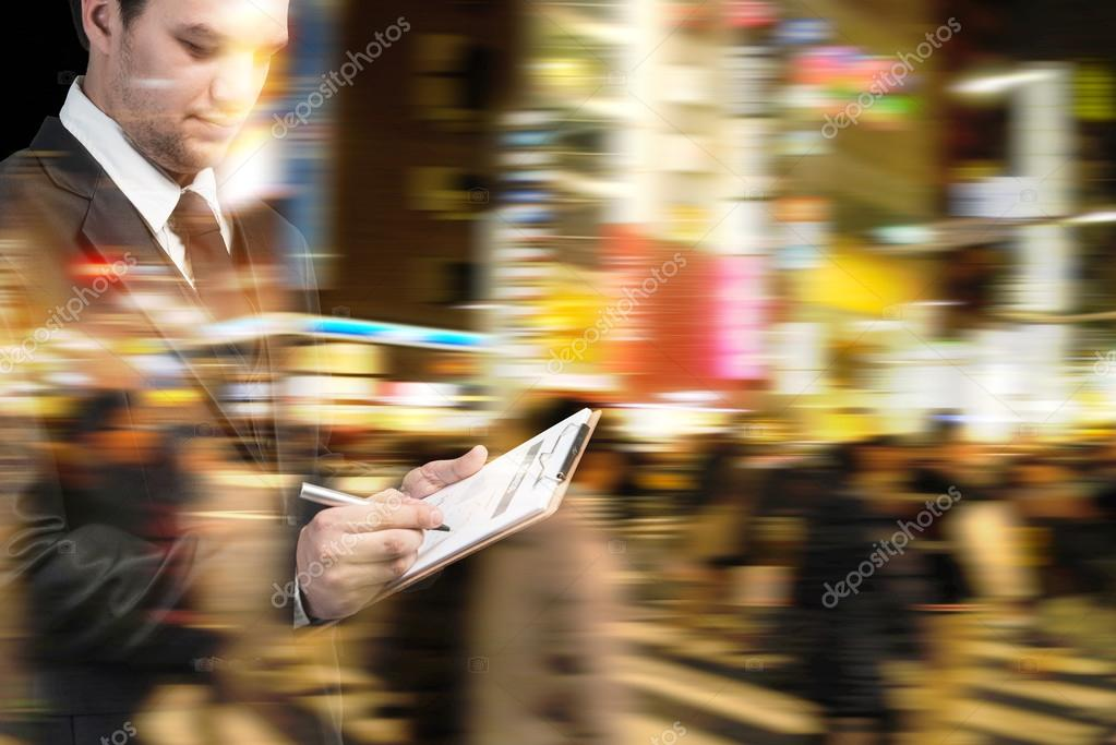 Businessman at rush hour walking in the city street,Double exposure and motion abstract, accessories, actions, backgrounds, blur, business, businessman, busy, cell, checklist, city, clipboard, communication, contemporary, cooperation, crowd, diligent