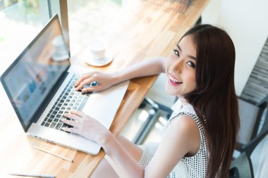 Beautiful business woman using a laptop computer