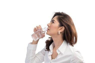 Beautiful business woman drinking water from bottle