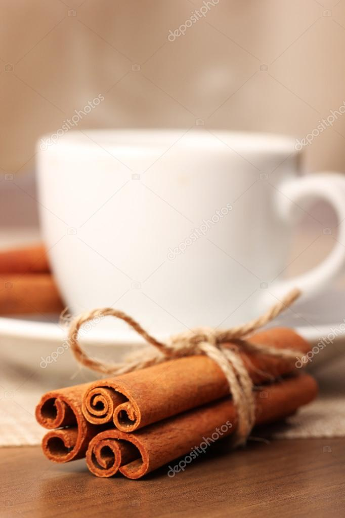 Cinnamon and beverage cup on wooden table series - 3