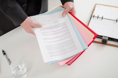 Businessman holding documents