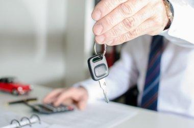 Car salesman holding a key