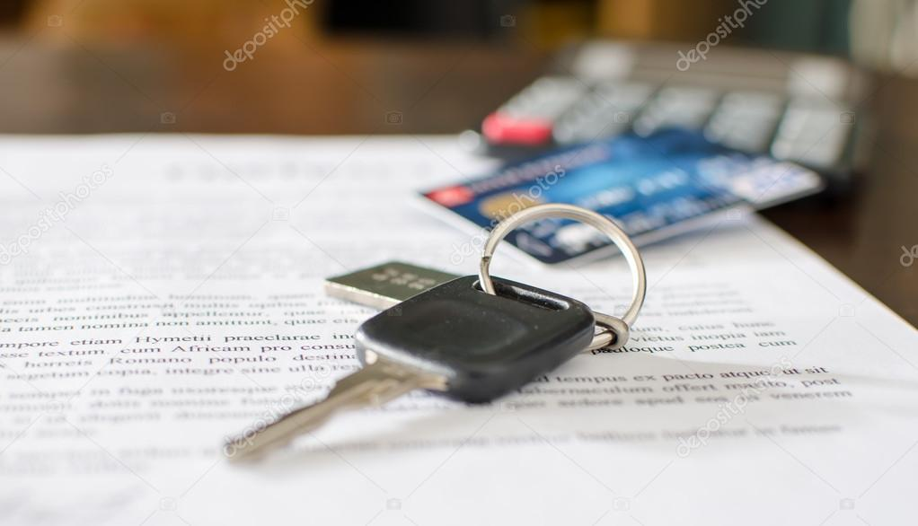 car key credit card on a signed sales contract stock photo