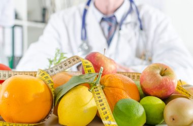 Doctor nutritionist with healthy fruits