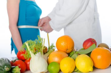 Doctor nutritionist measuring the waist of a patient