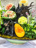 Photo Mix fruits carving in basket.