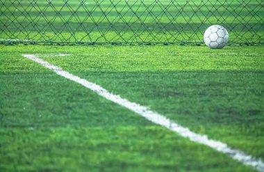 Football on field line.