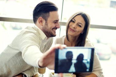 Couple making self portrait