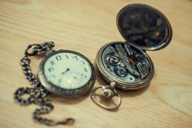 Vintage pocket watch on old wood