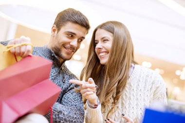 Couple looking at their shopping bags