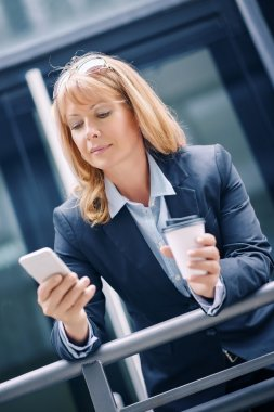 Businesswoman standing in front of an office building
