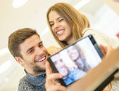Fotografie Young couple taking a selfie