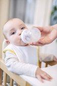 Fotografie Baby boy drinking milk