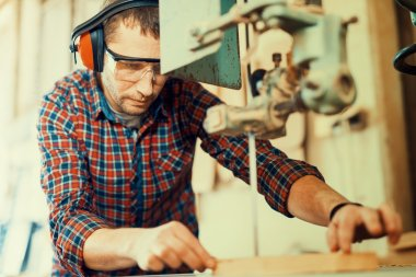 Close up of a young carpenter at work