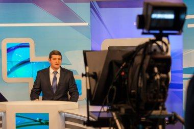 tv studio camera recording male reporter or anchorman. Live broadcasting