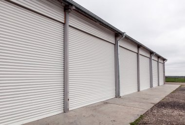 Storage units with roller shutter doors in industrial area