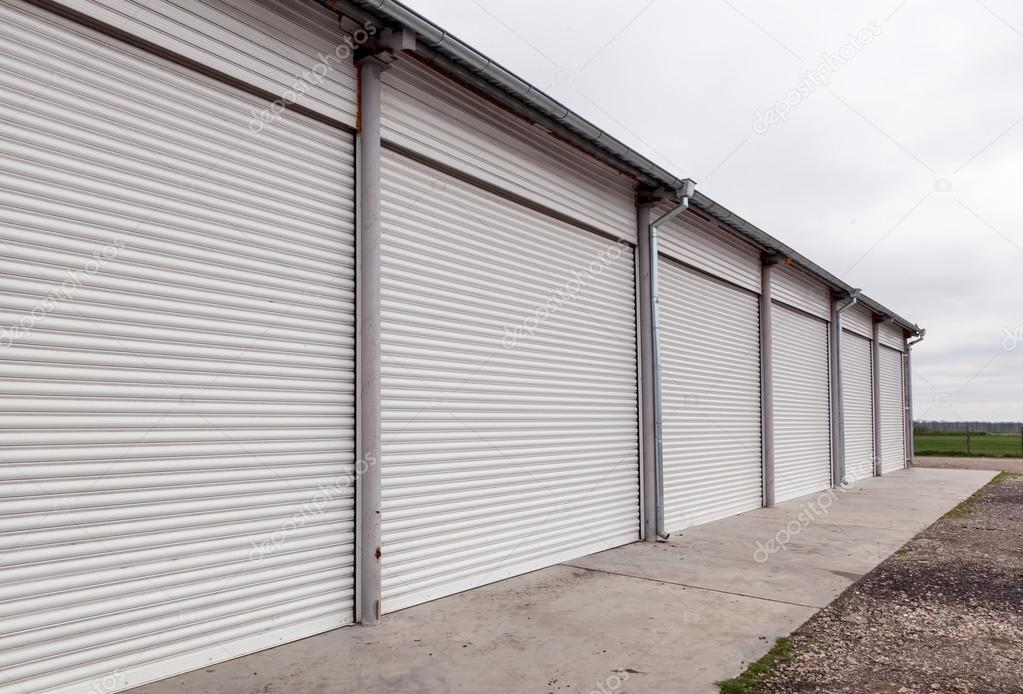 Storage units with roller shutter doors in industrial area u2014 Stock Photo & Storage units with roller shutter doors in industrial area u2014 Stock ...