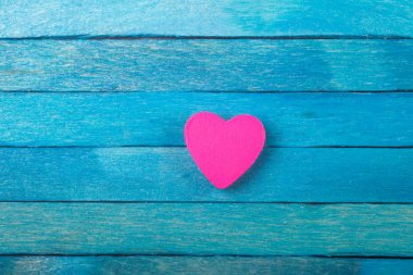 Decorative pink heart on blue wooden background stock vector