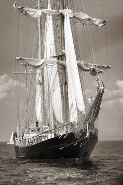 Old ship with white sales in black and white