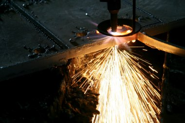 Industrial Laser cutting metal with sparks