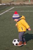 Photo little boy playing with soccer or football ball. sports for exercise and activity.