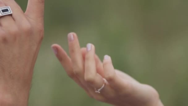 Couple in love holding each others hands. Close-up.