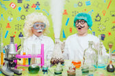 Photo Two boys doing chemical experiments in the laboratory