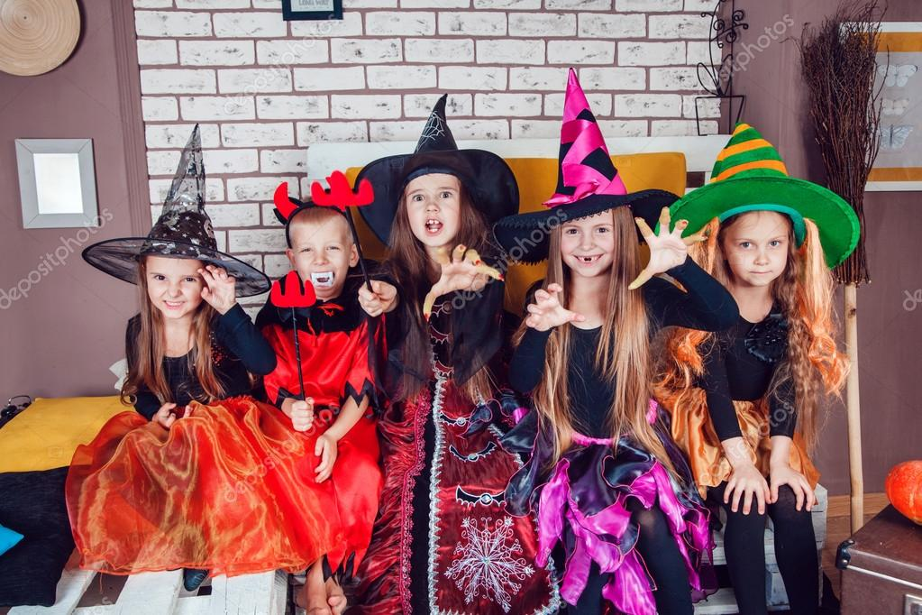 boys and girls dressed up in halloween costumes show emotions of witches and vampires halloween party with group children photo by airkost - Girls Halloween Party