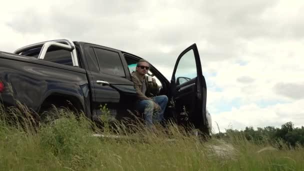 man drinking coffee near his car 4K 02