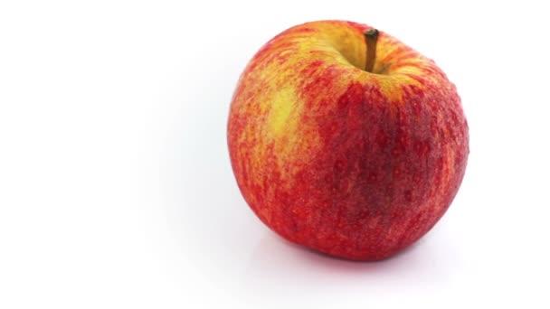 Fresh apple rotating at white background