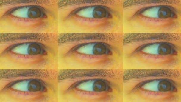 Psychedelický efekt - mozaika lidských očí pestrobarevná. Extrémní zblízka doširoka otevřené oko v psychedelickém bizarním efektu.