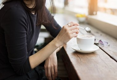 Instagram looking picture of girl drinking coffee